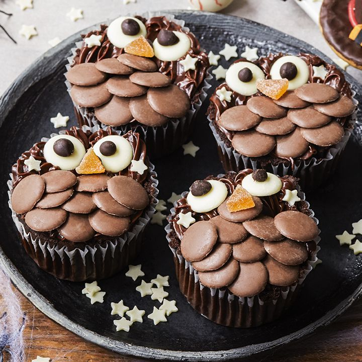 slice the top off a chocolate muffin and let kids layer on chocolate buttons and jellies find this halloween recipe - Halloween Bakery Ideas