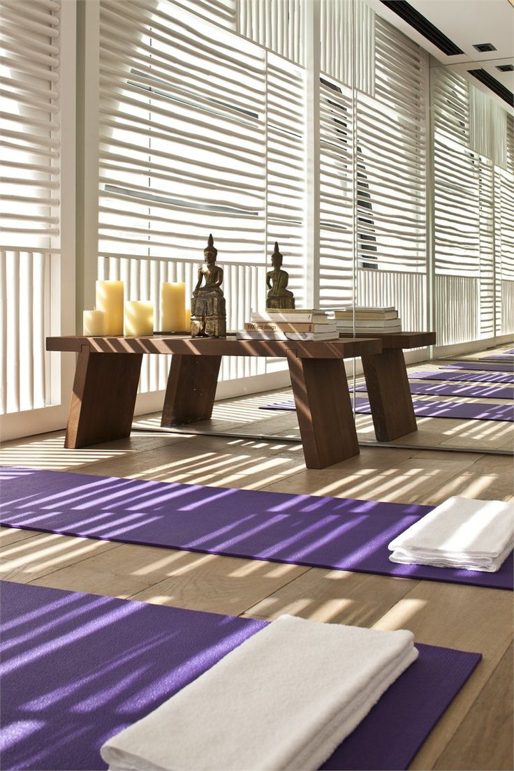 I love how they have the yoga mays already set up for the guests to maximize the space