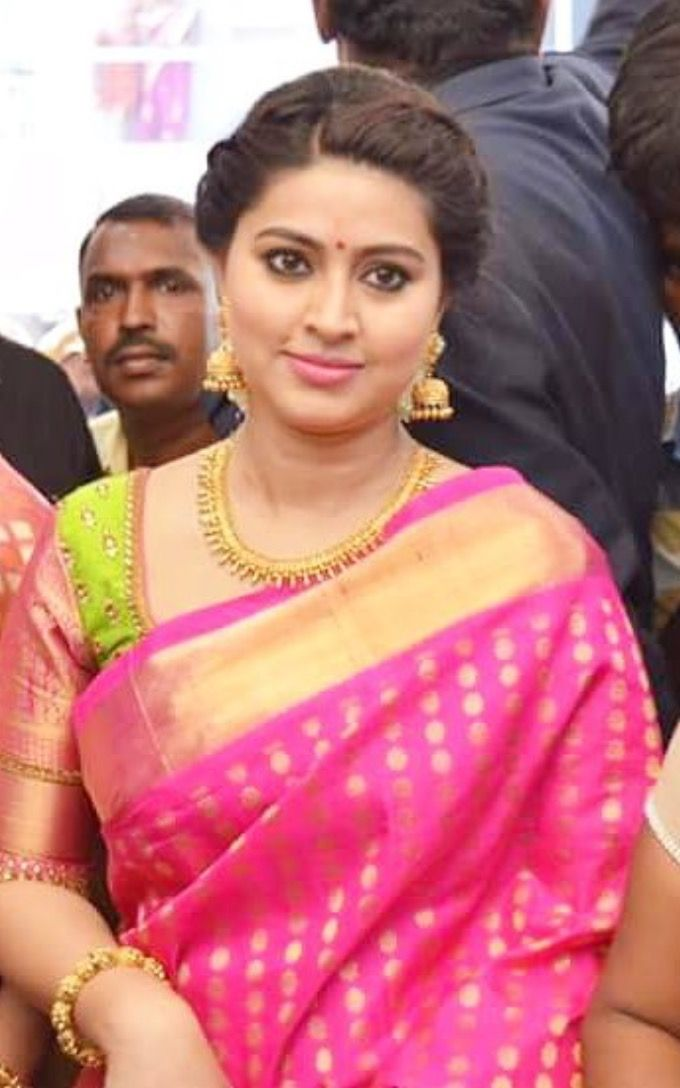 Typical indian dressy look - pink and gold sari, gold jewelry