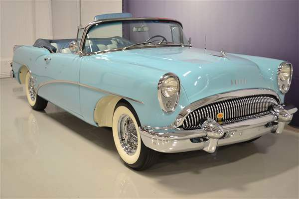 1954 Buick Skylark convertible. I especially love the color! They don't make 'em like this anymore!