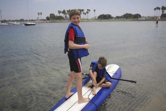 Boys went paddle boarding together at Mission Beach in San Diego.  At Mission Beach with Nancy's Vacation Rentals http://www.nancysvacationrentals.com/