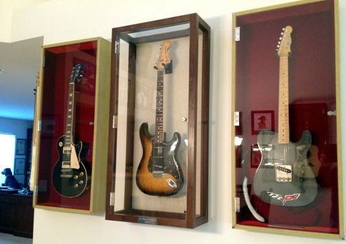 Guitar Display Cases: a wall mount guitar display case for a guitar. Electric and acoustic guitar display case models.