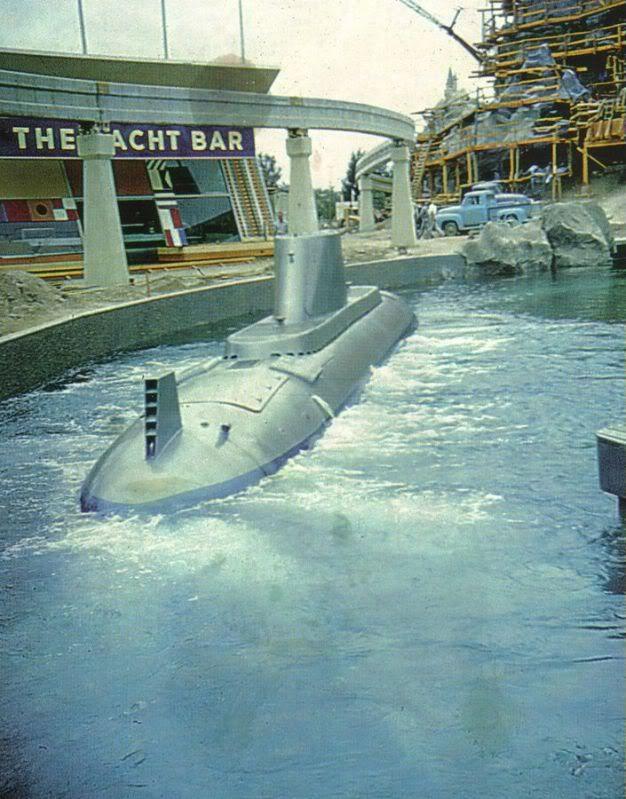 Pre-1959 Disneyland Submarine (note Matterhorn still under construction) glides past the Yacht Bar along the edges of Tomorrowland.