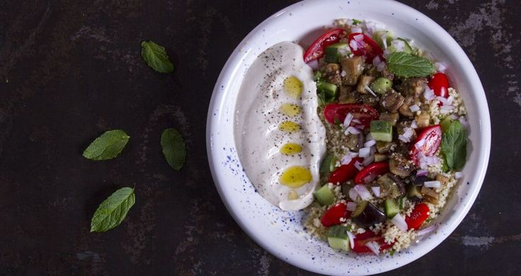 Yummy Tabbouleh salad. A healthy and tasty salad with couscous, cucumbers, cherry tomatoes, parsley mint and a refreshing yogurt dressing!!