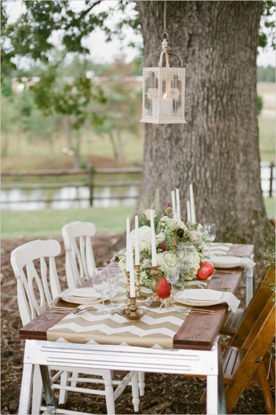 eclectic gold and white table decor #tabledecor #weddingreception #weddingchicks http://www.weddingchicks.com/2014/01/20/boho-garden-wedding/