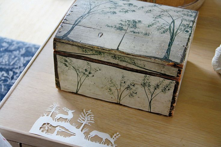 At the Mellon Estate...A box by the painter and inventor Rufus Porter near a woodland paper cutout.