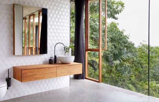Bathroom details featuring fittings by 'Goccia' by Gessi. The timber vanity and mirror cabinet was built by Jesse and designed by Anne-Marie. Photo – Sean Fennessy.