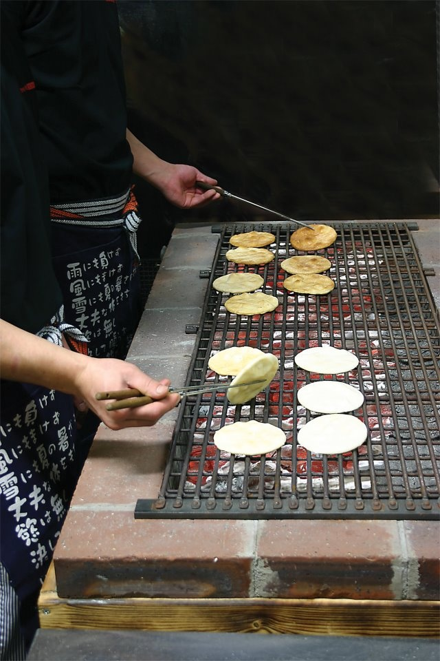 Craftsmen making a Japanese rice crackers.