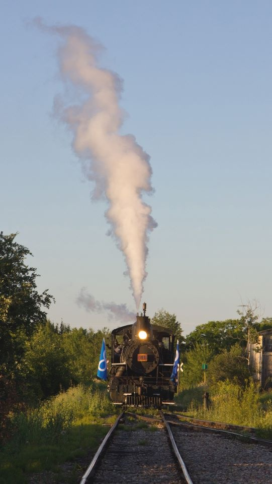 Alberta Prairie's steam-locomotive No. 41 blows of steam as the crew performs a safety valve check. Photo by David Thomas.