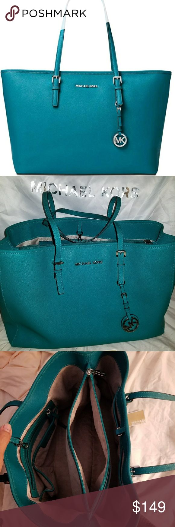 """💙💚 MICHAEL KORS JET SET MEDIUM TOTE 💚💙 Chic, functional and a bright pop of color. The Jet Set medium tote from MICHAEL Michael Kors featuring plenty of pockets to keep you organized.  Leather, Medium sized bag; 14"""" W x 10"""" H. silver-tone exterior hardware and logo medallion.  1 Dust bag is included MSRP $298 color is peacock. Michael Kors Bags Totes"""