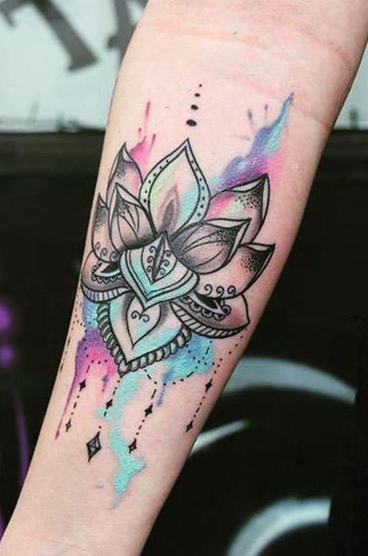 Watercolor Lotus Flower Wrist Tattoo Ideas for Women at MyBodiArt.com