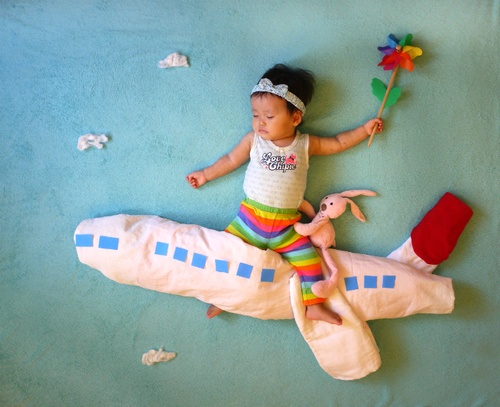 Japanese mom creates art with her sleeping baby