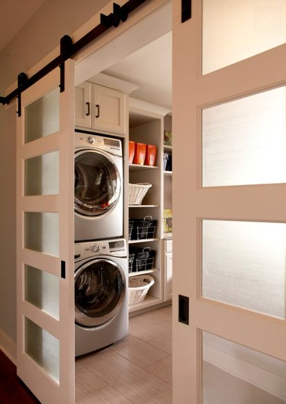 laundry room with modern barn doors
