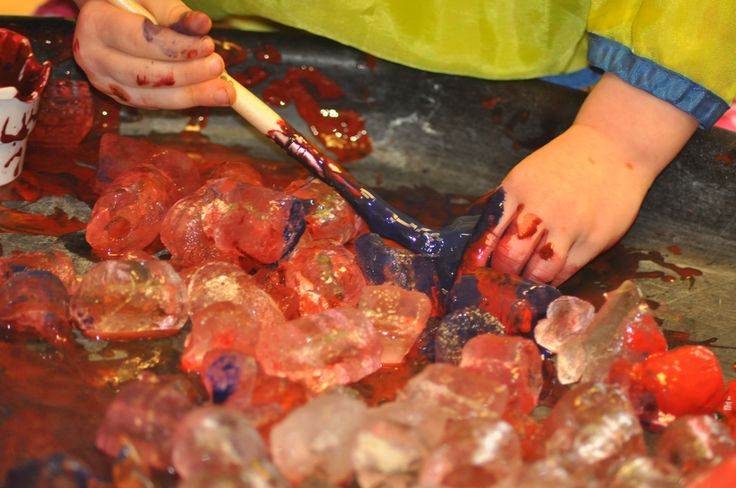 Toddlers learning about colour mixing