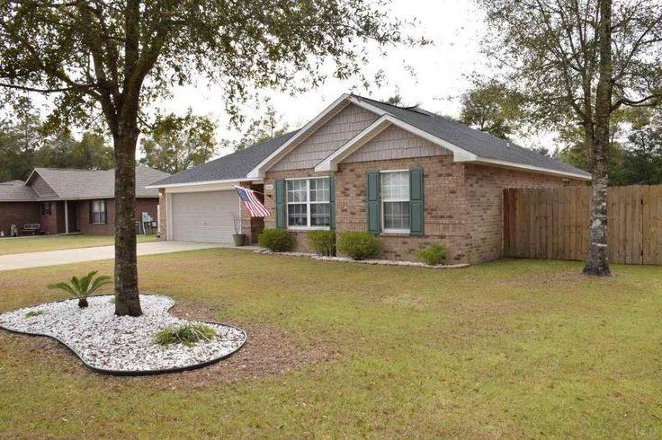 """Super cute 3/2 home with 2 car garage less than 12 miles to NAS Whiting Field! """"A"""" rated Hobbs Middle School and Milton High School!! Close to shopping, restaurants, and more! Convenient to I-10 for easy access to Pensacola and our beautiful beaches!! 1 year home warranty from First American Home Warranty paid for by the seller! #Milton #MiltonHighSchool #NASWhitingField #PensacolaBeach"""