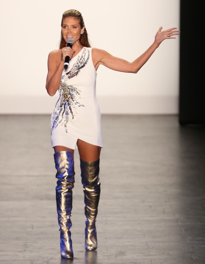 "Heidi Klum in gold thigh-high boots for the ""Project Runway"" Finale on September 9 at New York Fashion Week."