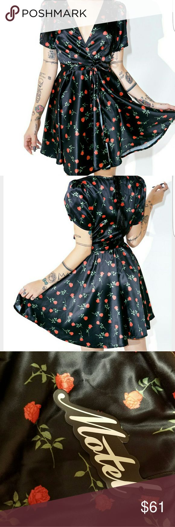 Motel Rose 'Vela' Wrap Dress from Dollskill Absolutely STUNNING rose satin dress! Sexy, vintage and all around gorgeous. You can pull this off with any type of shoe- heels, flats, boots...y'all this would look beautiful with anything. The floral pattern is so darling and it has a low cut and puffed sleeves so you'll feel like a real 60's gal. The dress is a M/L but could probably fit a small as well :) Dollskill Dresses
