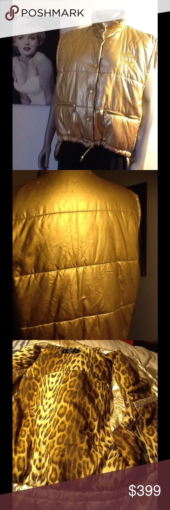 Rare metallic gold MCM vest puffer This is an authentic stunning MCM vest puffer jacket. It's been loved and has signs of wear on the outside of jacket. Some of the gold metallic has rubbed off. This can be resprayed with material paint. Or still worn like is now. This is a rare MCM vest jacket. Size 42 MCM Jackets & Coats Puffers