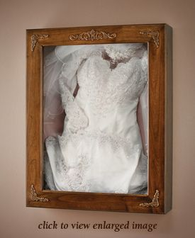 A company that makes shadow boxes for your dress that preserve the dress and beautifully display it at the same time!