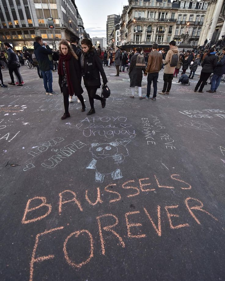 People have written hundreds of messages on the asphalt at place de la Bourse in the centre of #Brussels since last night, when bombs exploded at the airport and at a metro station there - killing and wounding scores of people. Photo via Martin Meissner for the Associated Press. Extensive coverage of the terror attack at our website and mobile apps. #jesuisbrussels #jesuisbruxelles #brusselslockdown #prayforbrussels #belgium