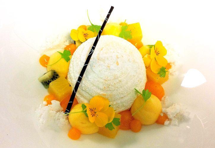Pavlova with passion fruit foam, coconut snow, compressed pineapple, mango gel and lemon cream.
