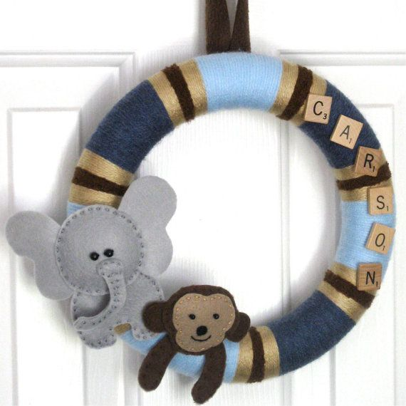 Baby Boy wreath www.bourdiers.ets... So simple & adorable! Love the Scrabble letters.