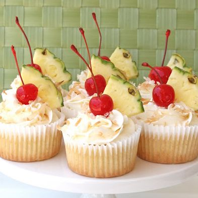 Pina Colada Cupcakes Recipe -I've been playing with this recipe for over a year, and I'm very happy with the final results.  I'll be doing a dessert display for a big luau party this weekend and wanted to perfect this recipe before the party.  I took this batch to a church pot luck tonight and got lots of great reviews.  The Pina …