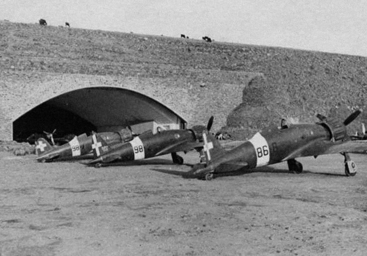 Italian fighters parked outside one of the two large, fortified underground hangars at Marghana Airfield, c.1942. Source: Coll. Vincent Abbate