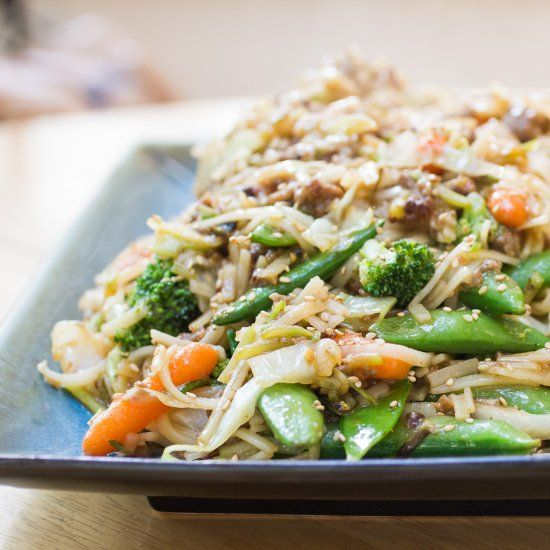 Stir fried rice noodles loaded with sesame vegetables and your choice of protein.
