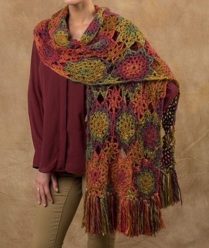 Crochet Rory Shawl - It's hard to believe that this colorful shawl is made with just one color of yarn. The motifs are joined as you are making it, which means there is little finishing.