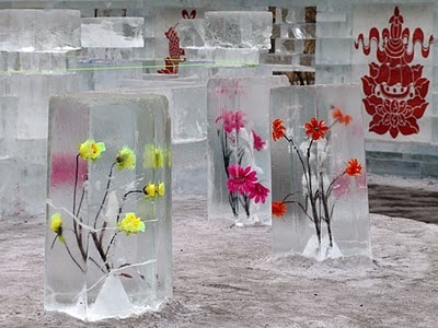 Freeze flowers in blocks of ice for outdoor party...