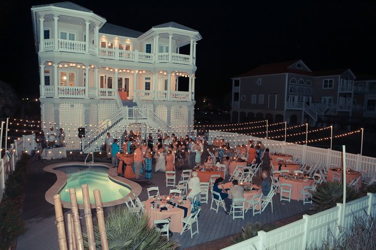 you could do something like this for after the ceremony, string lights all around and set up the tables on the deck or pool area if there is room. Although I see someone falling in the pool after a few drinks ;)