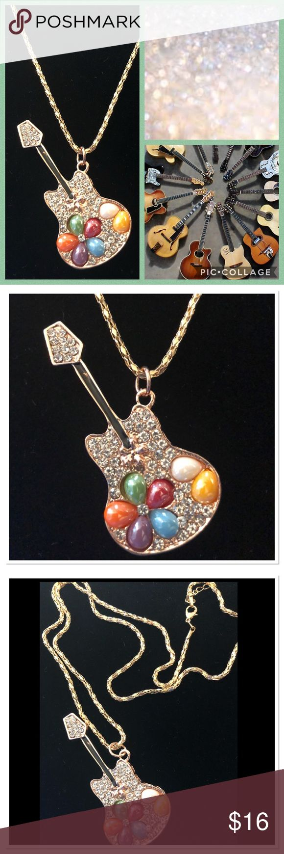 """Rhinestone Guitar Necklace Beautiful pendant adorned with rhinestones &multi colored stones. Great for music lovers! Gold rope chain is 28"""". NEW Jewelry Necklaces"""