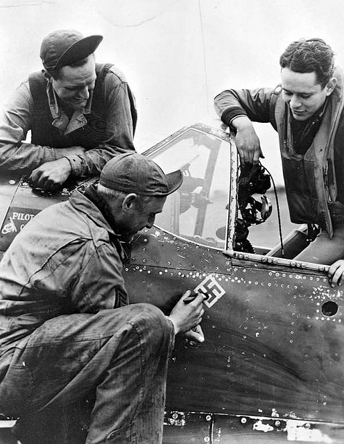 Major Charles J. Rosenblatt with his ground crew (1944). He was credited with destroying four Nazi planes and damaging three others. Rosenblatt served in the U.S. Air Force for 22 years, and was a fighter pilot during both World War II and the Korean Conflict. He received two Distinguished Flying Crosses, the Air Medal, and three Oak Leaf Clusters in World War II alone.