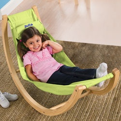 "Does playroom furniture get any cooler? Kids will love chillin' out in their own gently-rocking, indoor hammock (the perfect nook to dive into a book!). Every child on the block will want to take a turn. Take it outside on a nice day, too. With free-standing wood frame, stain-resistant fabric, and removable headrest. Quick assembly. For ages 3 and up, up to 100 lbs. 46""L. Imported"