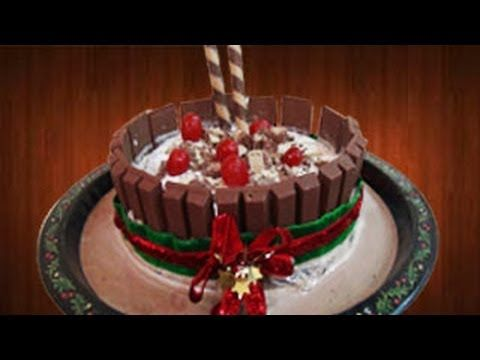 This Kit Kat cake will be the show piece of any party, especially this festive season. You can also fill the cake with choco-chip, M&M's, cookie crumbs or other candy if you wish.  If you like this video please let us know by clicking the thumbs up icon &/or commenting below! We love good feedback!  Also if you have any edible craft ideas, please share it with us in the comments section below!