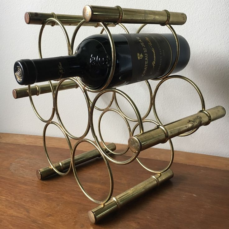 Glam up your wine collection with this amazing midcentury bamboo style brass wine rack. 🍷