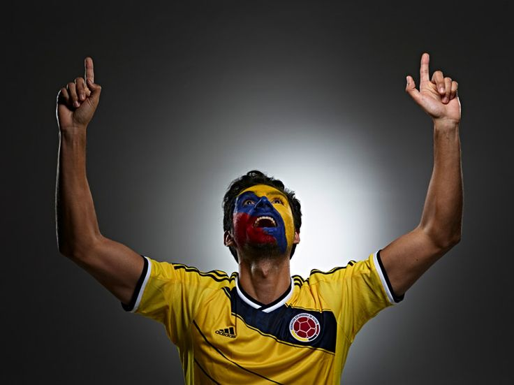 Colombian Futbol soccer fan face paint from Colombia photo by Monte Isom #worldcupfan #colombiafutbolfan