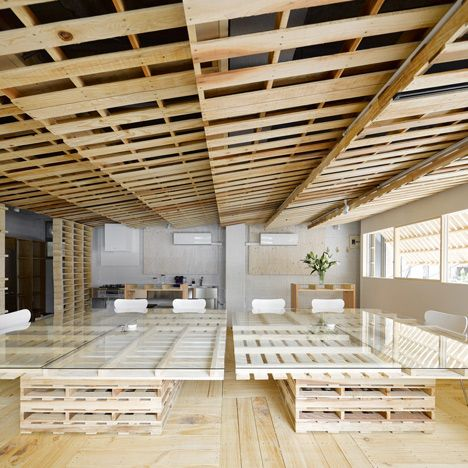 Over 100 wooden transport pallets were broken down to create floorboards, wall coverings and furniture for a temporary office space in Tokyo