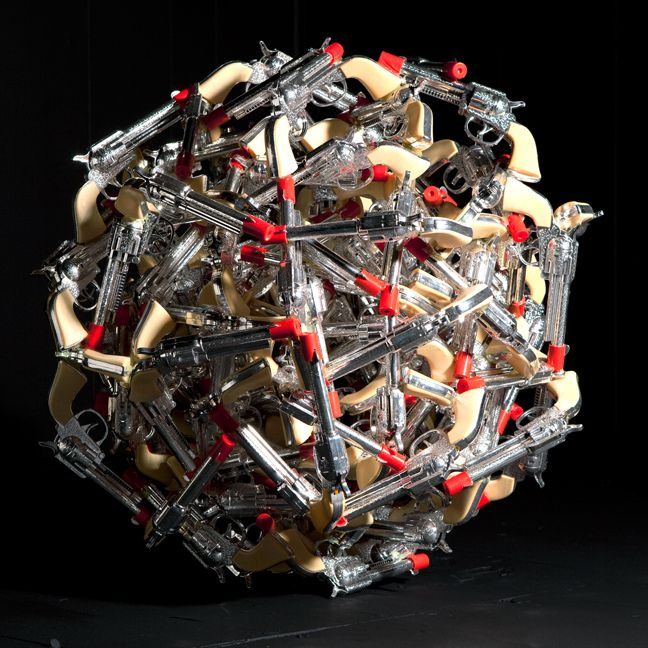 "Max Shuster: Toy Gun Sculpture,  toy guns, glued together, measures 32"" in diameter"