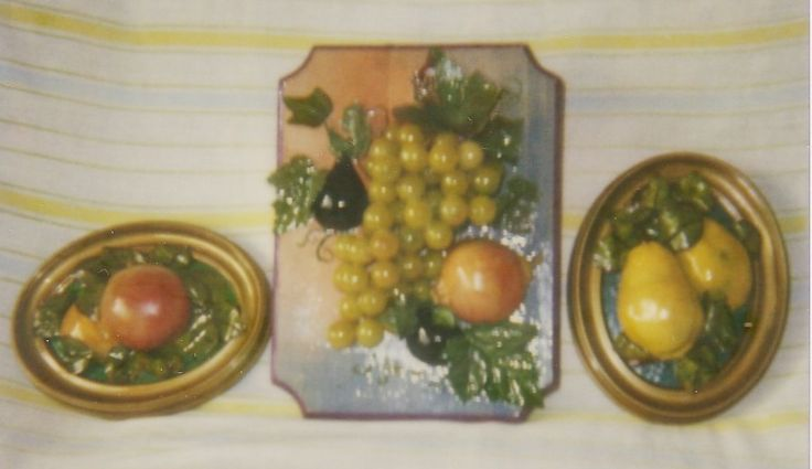 Made this in 2000 - wooden plaque, painted and edged, Mediterranean fruit glued, stapled, ModPodged to it (in center) - The other 2 in frames, mounted on cardboard -.   Makes great wall decor for our Croatian Condo Dining area.