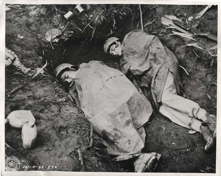 1944- U.S. 37th Division infantrymen sleeping in a foxhole on Bougainville.