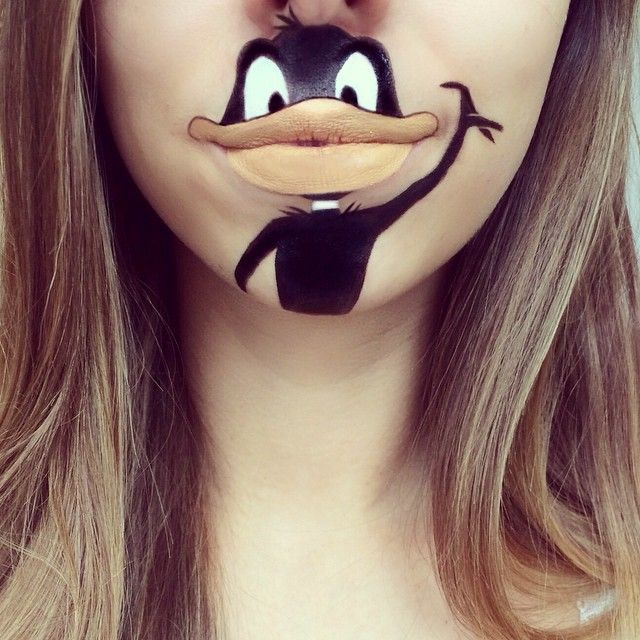 Cartoon lip-art has won London makeup artist Laura Jenkinson a large internet following. She uses theatrical makeup and occasionally lipstick to create her portraits, which have included the likes of Roger Rabbit and the Lion King.