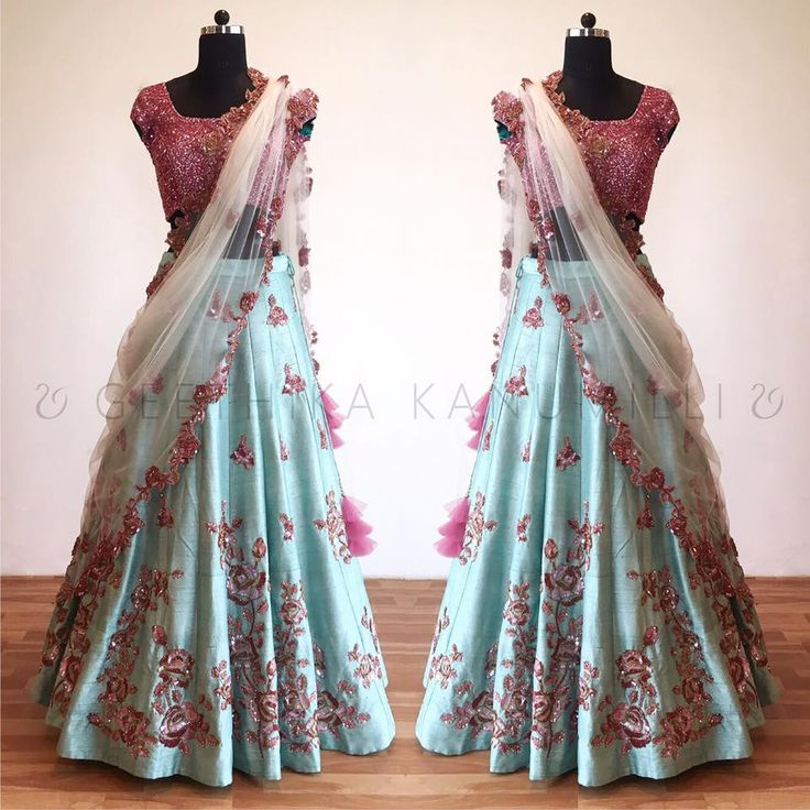Beautiful ice blue color lehenga and pink color designer blouse with net dupatta. Lehenga with floret lata design hand embroidery thread work. 11 September 2017