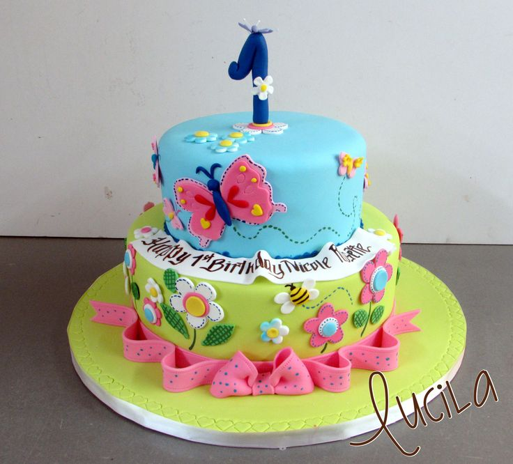 Fondant cake with hand made fondant number and butterflies