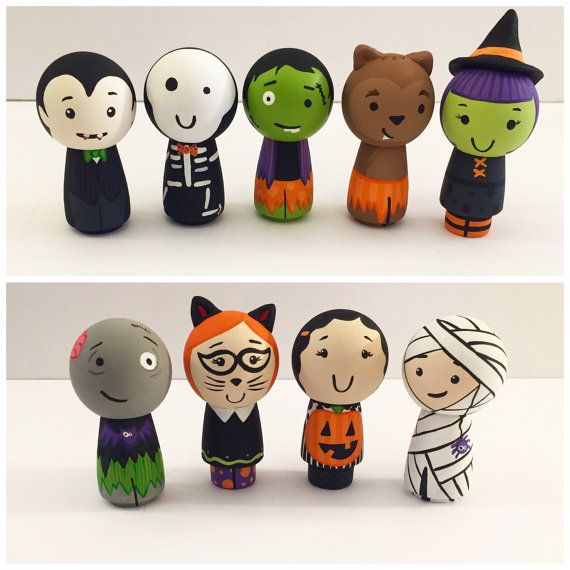 This listing for any four of these adorable Halloween pegs. Please specify which youd like at check out. We hand paint each and every peg doll
