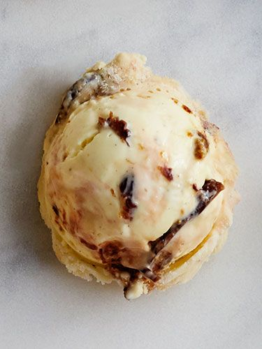 Soak 1½ cups finely chopped dried figs in 1 cup Armagnac brandy for 1 hour; drain. Swirl figs, ¾ cup butterscotch caramel sauce, and ½ tsp. sea salt into prepared gelato before freezing in step 3.   - CountryLiving.com