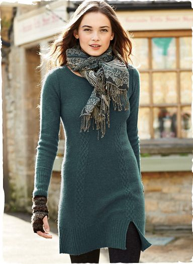 Pretty sweater dressing in sublimely soft woolen-spun royal alpaca—the primo grade of baby alpaca. Terrific over leggings, this go-anywhere knit tunic-dress features dimensional cable stitching along the seams, with long ribbed cuffs and a single slit in front.