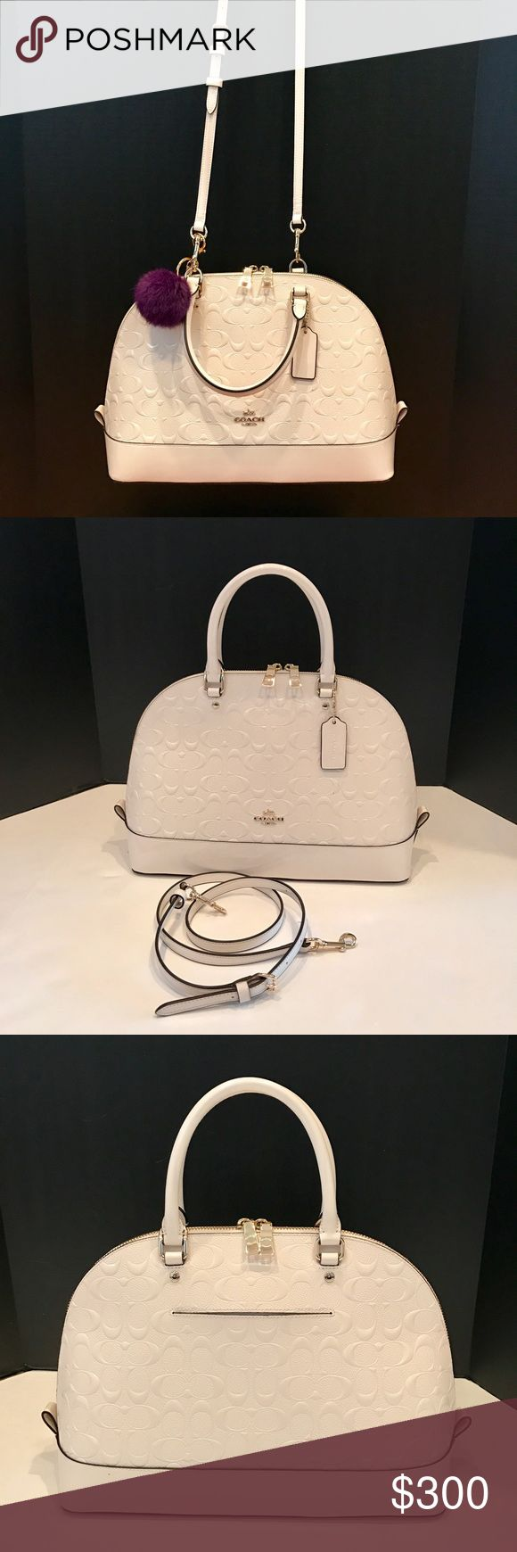 """Coach CrossBody Satchel Ivory signature satchel with removable cross body strap. Gorgeous color that looks striking while using the handles on your arm or as a cross body purse. Cloth interior has 1 zip and 2 slip pockets (oops, will add that photo!). Exterior has a back slip pocket. Brand new condition, just one tiny mark on front below Coach tag in pic #4. Handle drop 4"""". Strap drop about 15-24"""". Coach Bags Crossbody Bags"""