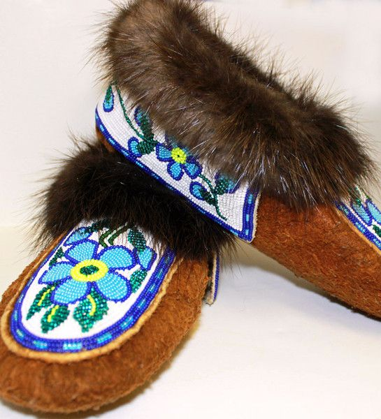 Hide slippers with beaded flower design. Cuffs are also fully beaded with beaver fur.